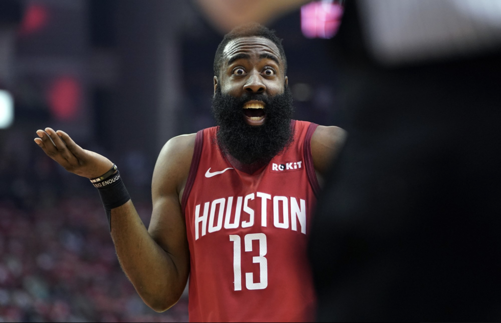 James Harden telling Steph Curry a joke
